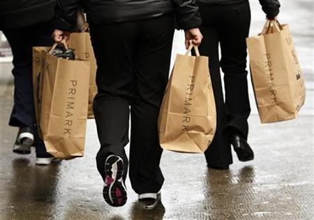 Shoppers carry Primark bags in London