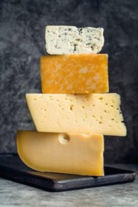 close-up-delicious-pile-cheese-top-each-other